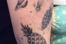Grapes, planet and pineapple tattoos