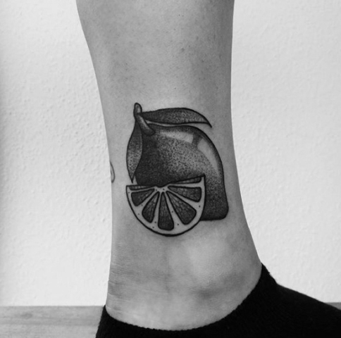 Lemon and slice tattoo on the ankle