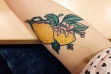 Lemons and flowers tattoo on the hand