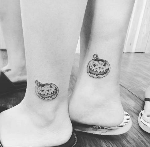 Matching tattoos on the ankles
