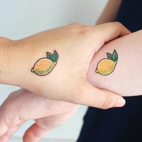 Matching tattoos on the hands