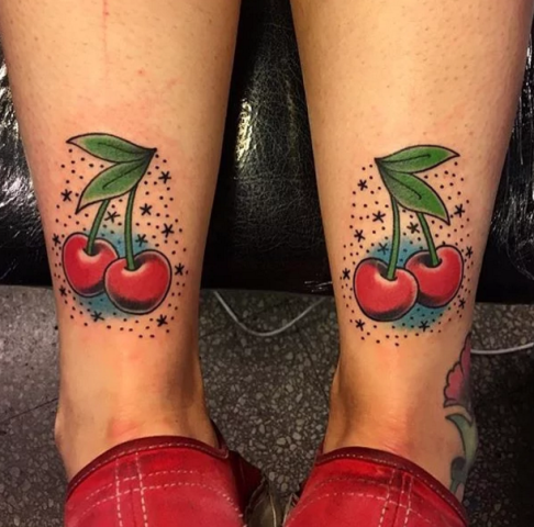Matching tattoos on the legs