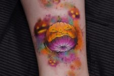 Orange and purple pumpkin tattoo
