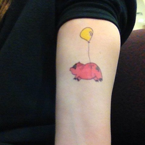 Piggy and yellow balloon tattoo