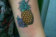 Pineapple and flower tattoo