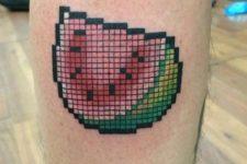 Pixel watermelon tattoo on the leg