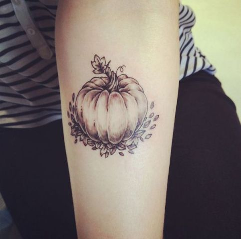 Pumpkin and leaves tattoo on the arm