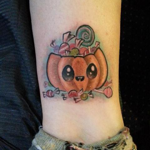 Pumpkin with candies tattoo