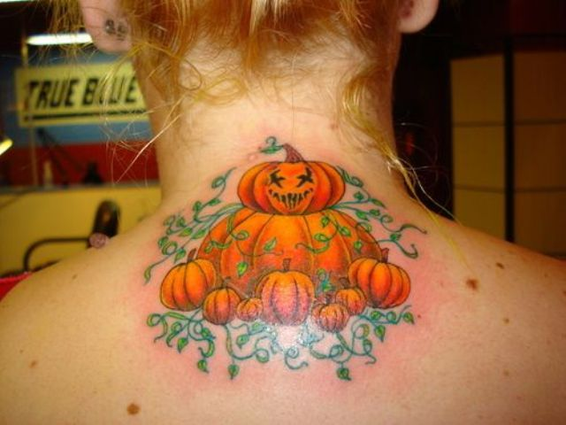 Several pumpkins tattoo on the neck