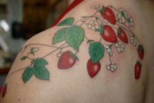 Several strawberries tattoo on the shoulder