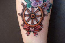 Ship wheel with flowers tattoo idea