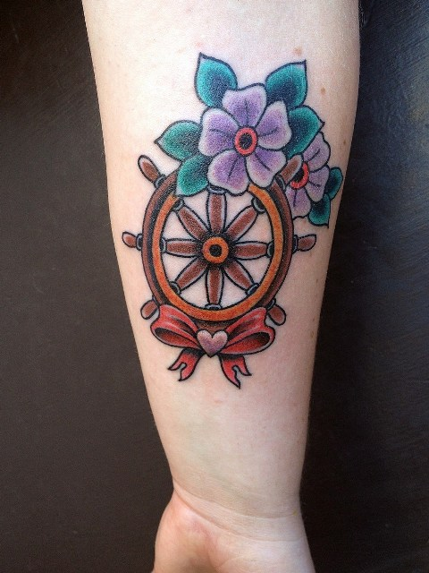 Ship wheel with flowers tattoo idea
