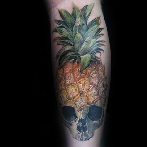 Skull and pineapple tattoo on the leg
