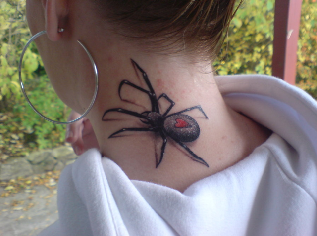 Spider and red heart tattoo