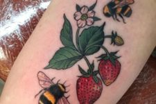 Strawberries and bees tattoo on the arm