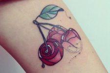 Three cherries tattoo on the arm