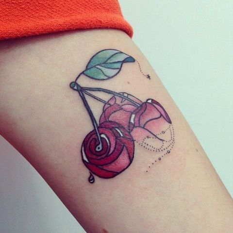 Three cherries tattoo on the arm