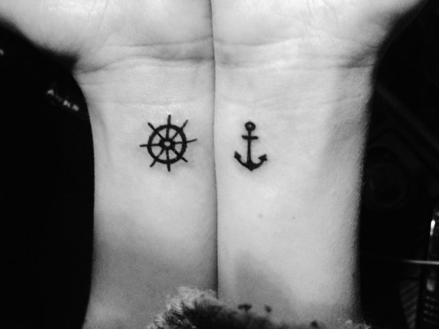 Tiny ship wheel tattoo on the wrist