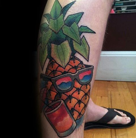 Tropical styled tattoo on the leg