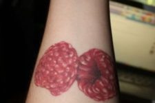 Two berries tattoo on the forearm
