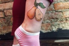 Two pears tattoo on the ankle