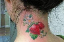 Two strawberries and flowers tattoo on the neck