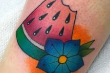 Watermelon slice and blue flower tattoo