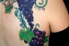 Wine glass and grape tattoo on the back and side