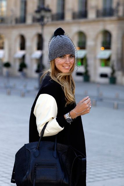 With black and white coat and tote