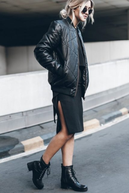 With black loose top, black knee-length skirt and ankle boots