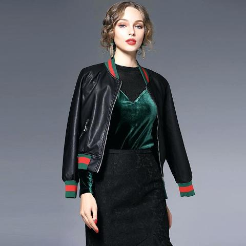 With black shirt, emerald velvet top and high-waisted skirt