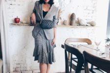 With black shirt, gray jacket, checked ruffled skirt, black flat shoes and beret