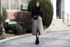 With black shirt, midi skirt and black boots
