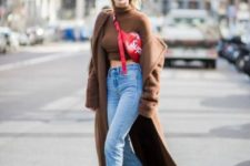 With brown turtleneck, jeans, golden boots and maxi coat
