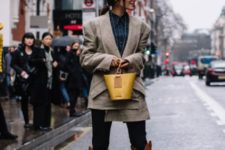 With button down shirt, skinny pants, yellow bag and jacket