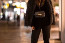 With fur coat, black jacket, black crop trousers and patent leather boots