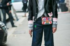 With gray hoodie, flare pants and colorful mini bag