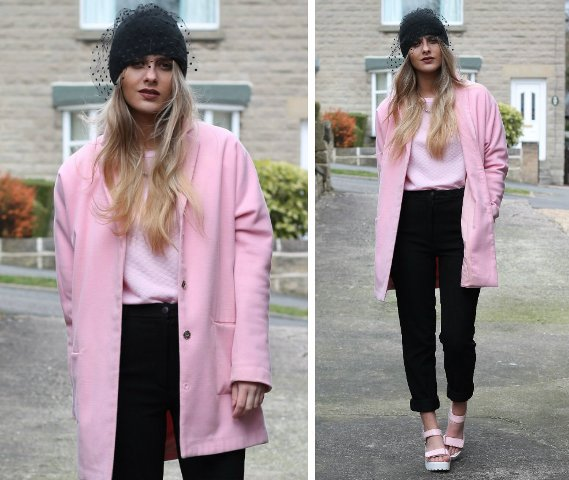 With light pink sweatshirt, pink coat, black trousers and platform shoes