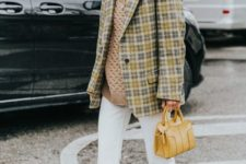 With loose sweater, checked long jacket, white trousers and small bag