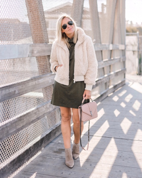 With olive green dress, pale pink bag and suede boots