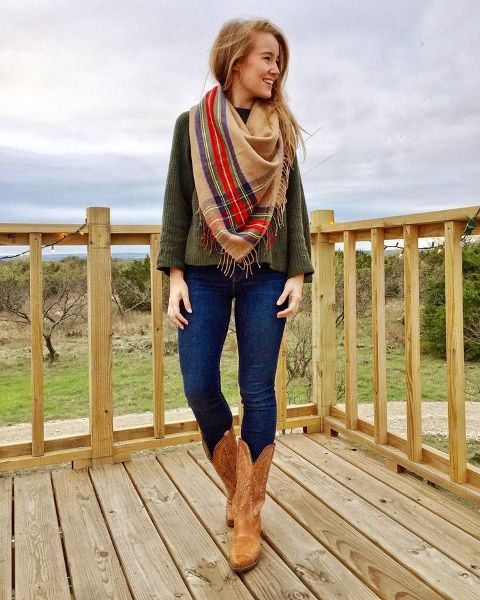With olive green sweater, jeans and printed scarf
