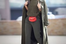With one shoulder sweater, maxi coat, olive green pants and red pumps