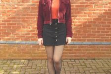 With orange turtleneck, black mini skirt and suede boots
