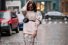 With oversized sweater and floral maxi skirt