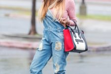With pink sweater, denim distressed jumpsuit, three colored bag and lace up boots