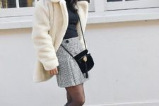 With plaid skirt, crossbody bag, high boots and black shirt