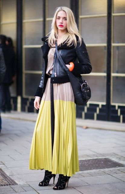 With pleated maxi dress, high heels and black bag