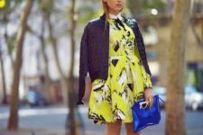 With printed dress, black and white shoes and blue clutch