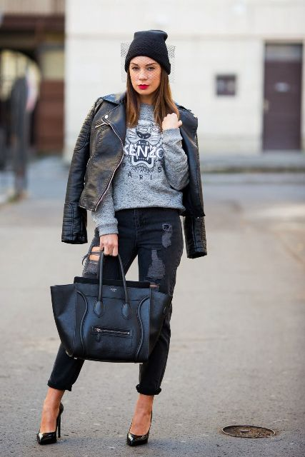 With sweatshirt, leather jacket, skinny pants, high heels and black tote
