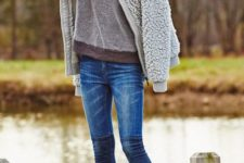 With sweatshirt, skinny jeans and heeled boots